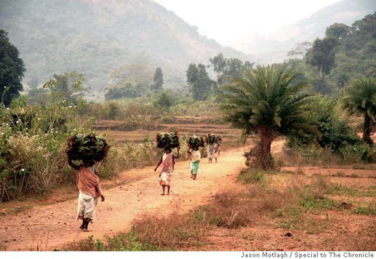 indiaXX_orissa_ph01.jpg Dongria women walk as far as 10 miles on uneven footpaths to bring their goods from villages in Niyamgiri to the nearest town market. Jason Motlagh / Special to The Chronicle