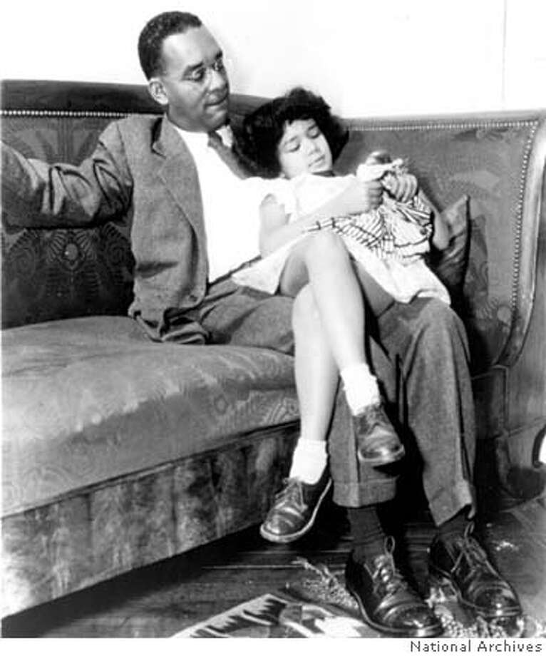 Richard Wright in his living room in Paris, circa 1949. Photo: National Archives this image is a scan from our photo files. caption didn't provide the ID of that little girl. Photo: National Archives