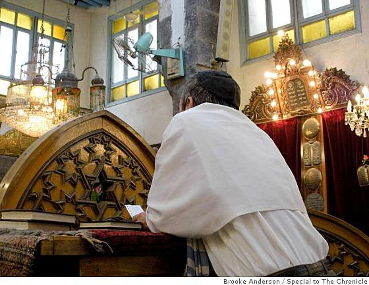 Fuad Halwani prays during a Saturday morning prayer service at the only remaining functional synagogue in Damascus, Syria