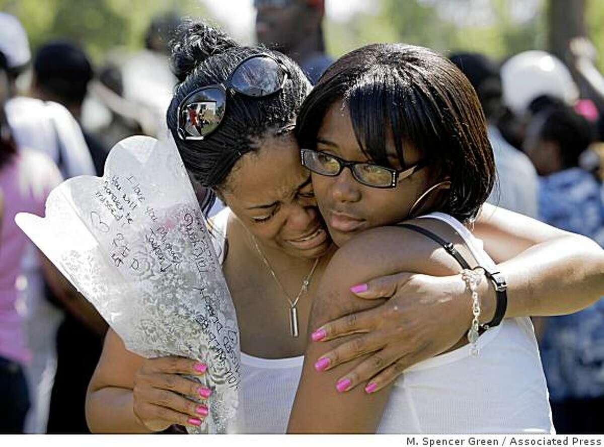 Tanisha Williams, 35, left, cries on the shoulder of her daughter Tiaunah Williams, 14, outside the boyhood home of pop star Michael Jackson Friday, June 26, 2009, in Gary, Ind. Jackson, 50, died in Los Angeles on Thursday, June 25, 2009.