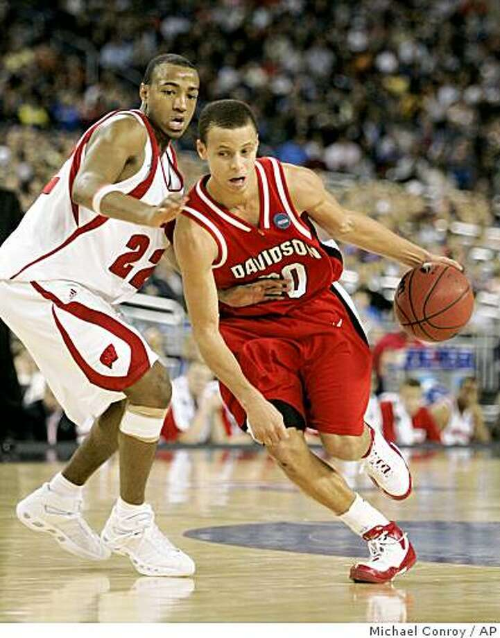 In this March 28, 2008 file photo, Davidson's Stephen Curry, right, drives past Wisconsin's Michael Flowers during the second half of the Midwest Regional semifinal in Detroit. Photo: Michael Conroy, AP