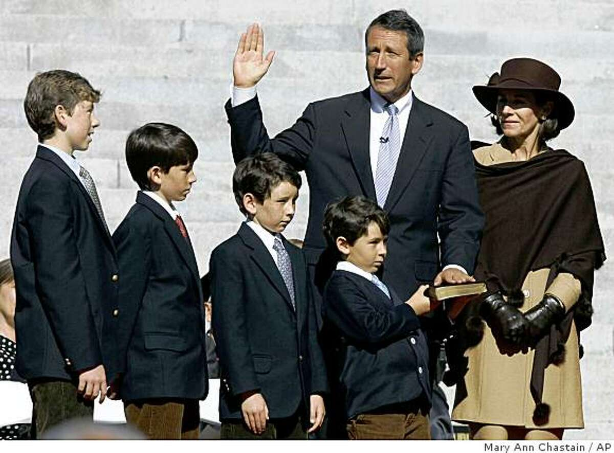 FILE - In a Wednesday, Jan. 10, 2007 file photo, South Carolina Gov. Mark Sanford takes the oath of office for a second term with his wife Jenny and sons, from the left; Marshall III; Landon; Bolton and Blake, during inaugural ceremonies at the Statehouse in Columbia, S.C. (AP Photo/Mary Ann Chastain, File)