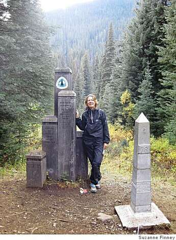 Suzanne Finney at the monument at the Canadian border. Photo: Suzanne Finney
