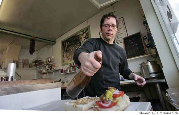 Pierre Houle makes a sandwich at Speedy's Grocery Store at Montgomery and Union. The store has been a Telegraph Hill favorite for more than 90 years. Houle is selling the business so he can spend more time at home.  Photo by Kim Komenich/San Francisco Chronicle MANDATORY CREDIT FOR PHOTOG AND SAN FRANCISCO CHRONICLE. NO SALES- MAGS OUT. Photo: KIM KOMENICH