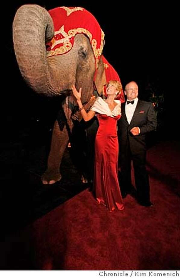 """Jillian Manus Salzman and Alan Salzman stand next to an elephant outside a """"politically incorrect"""" black tie Valentine's ball at their Atherton home. The event is a $1,000 a person fundraiser for the Stanford Cancer Center.  Photo by Kim Komenich/The Chronicle MANDATORY CREDIT FOR PHOTOG AND SAN FRANCISCO CHRONICLE. NO SALES- MAGS OUT. Photo: KIM KOMENICH"""
