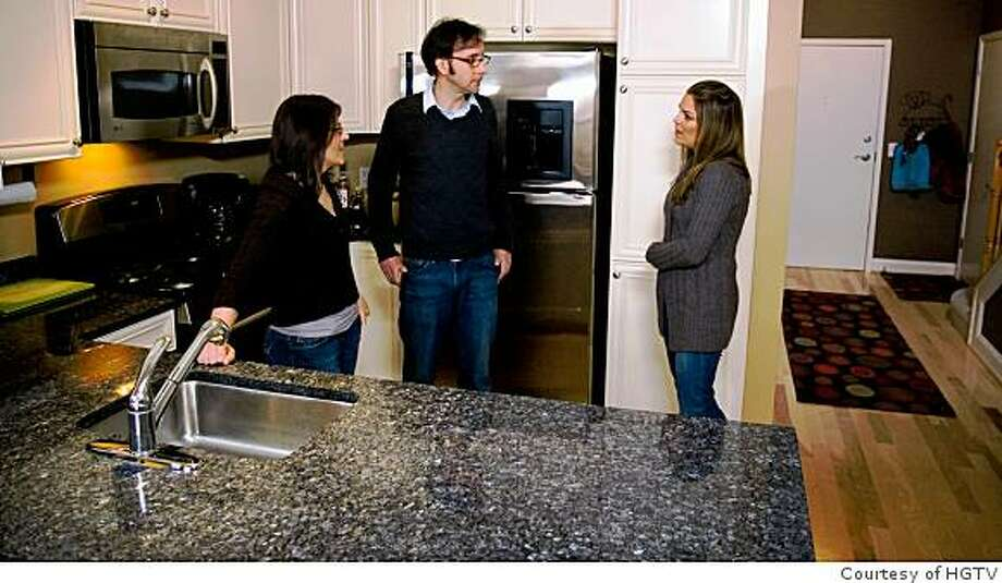 """Real Estate Intervention, HGTV's new reality show, tries to help home sellers face the fact that their home is worth less than they think. Host Sabrina Soto (right) talks with Jennifer Cihon and Thomas King in the kitchen of their recently sold condo in Arlington, Va., which is being used as a """"comp"""" to help educate another family on what their home is really worth. Photo: Courtesy Of HGTV"""