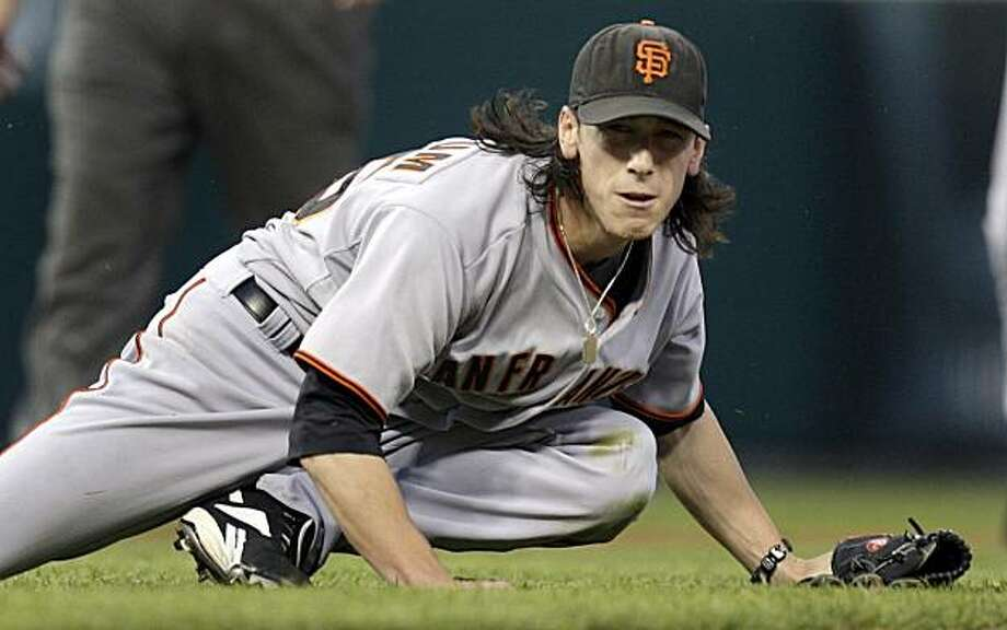 San Francisco Giants starting pitcher Tim Lincecum watches his throw to first for the out after he fielded a grounder by St. Louis Cardinals' Jason LaRue during the fifth inning of a baseball game Monday, June 29, 2009, in St. Louis. Lincecum threw a two-hitter in the Giants' 10-0 victory. (AP Photo/Jeff Roberson) Photo: Jeff Roberson, AP