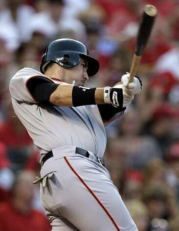 San Francisco Giants' Travis Ishikawa follows through on a three-run home run during the fourth inning of a baseball game against the St. Louis Cardinals on Monday, June 29, 2009, in St. Louis. (AP Photo/Jeff Roberson) Photo: Jeff Roberson, AP