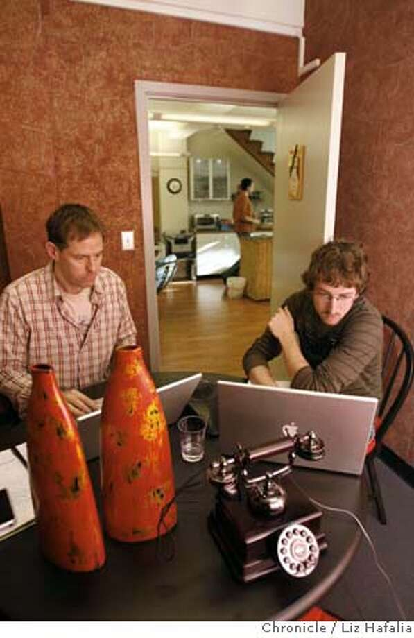 James Nicholson and David Pascual in the telephone room of Sandbox Suites, a co-working space.  Photo by Liz Hafalia/San Francisco Chronicle  Ran on: 02-19-2008  James Nicholson and David Pascual work in the telephone room of Sandbox Suites in San Francisco. It is one of a number of communal spaces that offer work areas to people without their own offices. Photo: Liz Hafalia