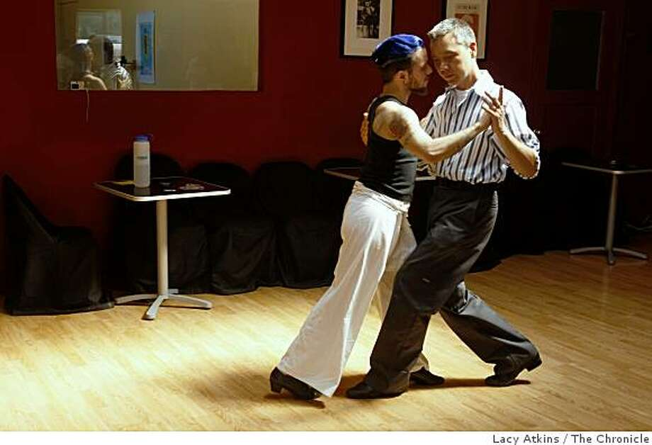 Solomon Michaels (left)  dances with Mark ( didn't want to give last night) during the tango dance lesson,  Sunday,  June 14, 2009, at the La Pisto dance studio in San Francisco, Calif. Photo: Lacy Atkins, The Chronicle