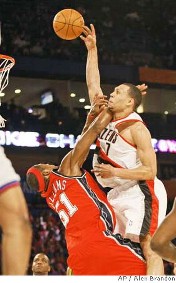 Portland Trail Blazers' Brandon Roy (7) shoots over New Jersey Nets' Sean Williams (51) during the first half of the Rookie challenge basketball game Friday, Feb. 15, 2008, at the NBA All Star Weekend in New Orleans. (AP Photo/Alex Brandon) EFE OUT Photo: Alex Brandon