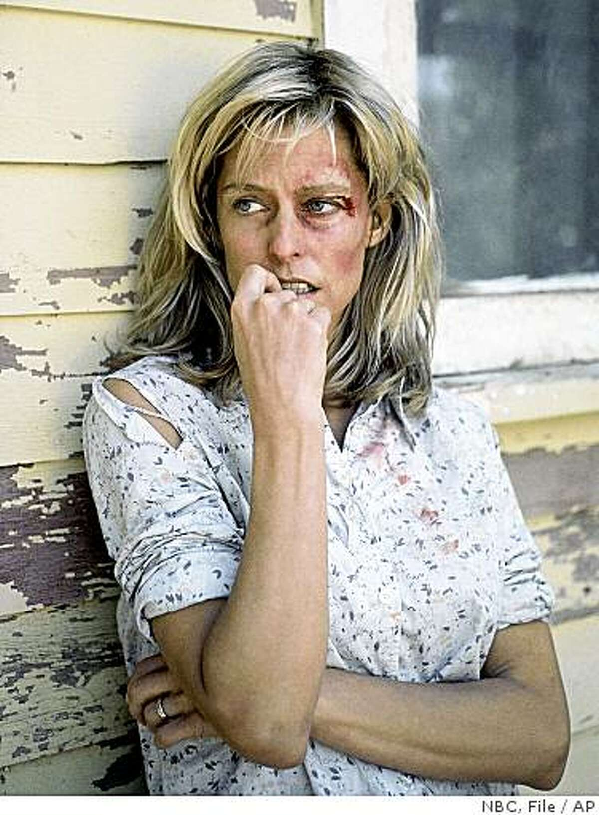 FILE - In this Aug. 1984 file photo originally released by NBC, actress Farrah Fawcett is shown in character in a scene from,