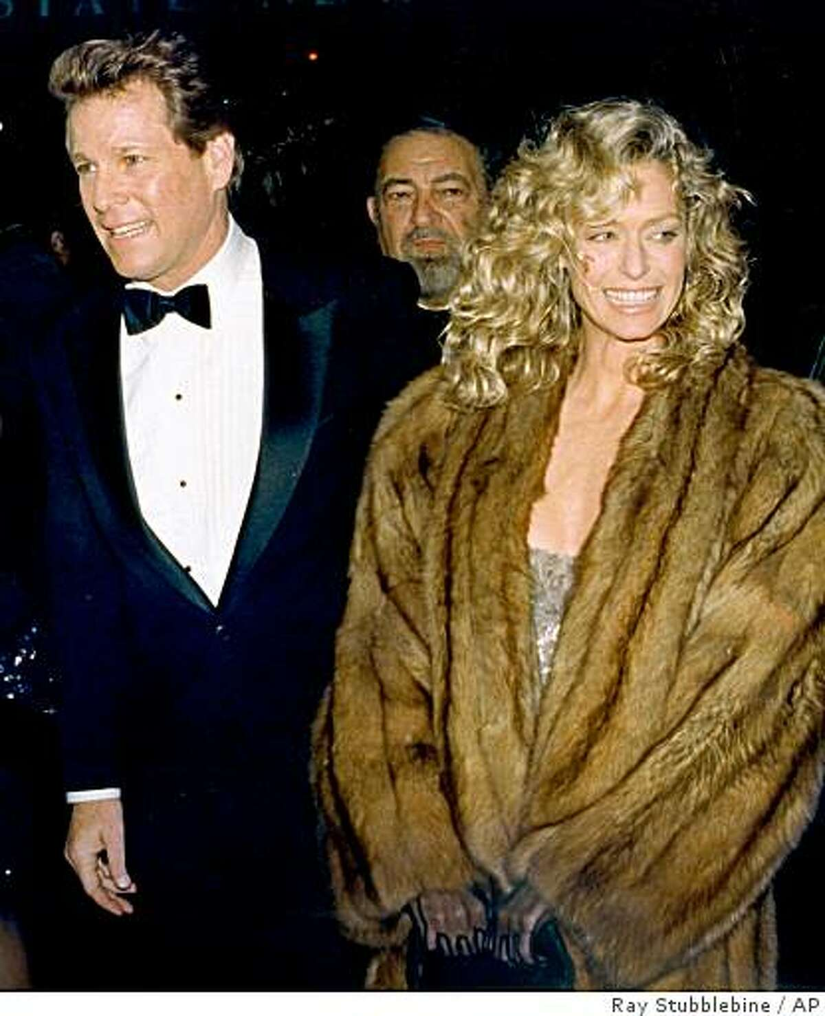 FILE - In this March 6, 1989 file photo, actors Ryan O'Neal and Farrah Fawcett arrive at the New York premiere of O'Neal's new movie,