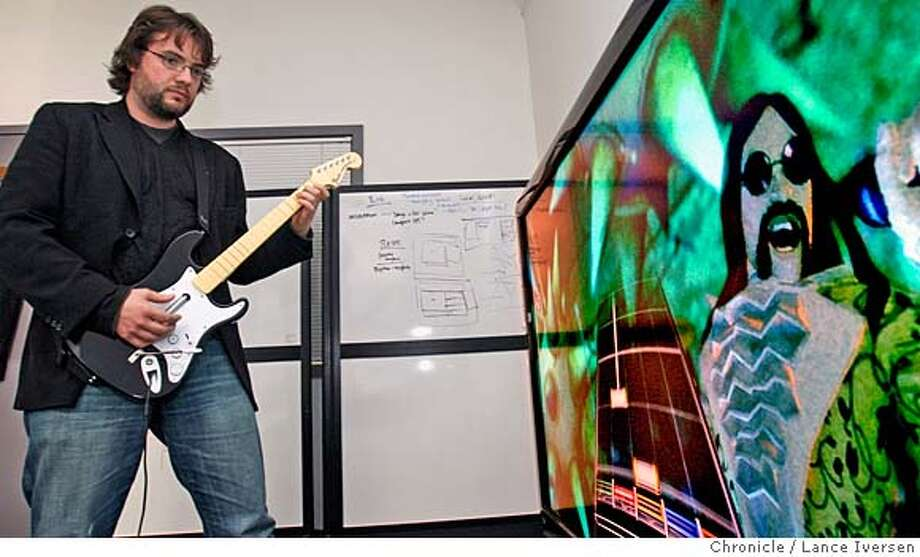 John Davidson co founder of What They Like an entertainment guide for parents plays the video game Rock Band in his San Francisco office. Davidson and co founder Ira Becker believe to bridge the generation gap and provide quality family play time their software programs will help guide parents to quality programs and games that don't have some of the negatives like the Blood and gore, F-word and sexual advances. By Lance Iversen/The Chronicle MANDATORY CREDIT PHOTOG AND SAN FRANCISCO CHRONICLE/NO SALES MAGS OUT Photo: Lance Iversen