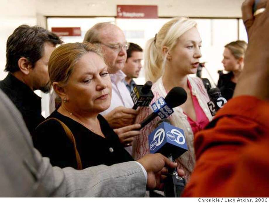 (left to right) Irina Sharanova, mother of Nina Reiser and Ellen Doren, Nina's best friend answer questions from the media surrounding them outside the courtroom where Hans Reiser appeared, Thursday Oct. 12, 2006 in Oakland, Ca. Hans Reiser appeared on charges that he murdered his estranged wife, Nina Reiser, who has been missing since Sept. 3 after she dropped off their children at his home. Her body hasn't been found, but police believe they have evidence showing that she's dead and that he killed her. (Lacy Atkins/The Chronicle) Ran on: 10-13-2006  Hans Reiser  Ran on: 10-13-2006  Hans Reiser  Ran on: 10-13-2006  Hans Reiser  Ran on: 10-13-2006  Hans Reiser  Ran on: 10-13-2006  Hans Reiser MANDATORY CREDITFOR PHOTGRAPHER AND SAN FRANCISCO CHRONICLE/NO SALES-MAGS OUT Photo: Lacy Atkins