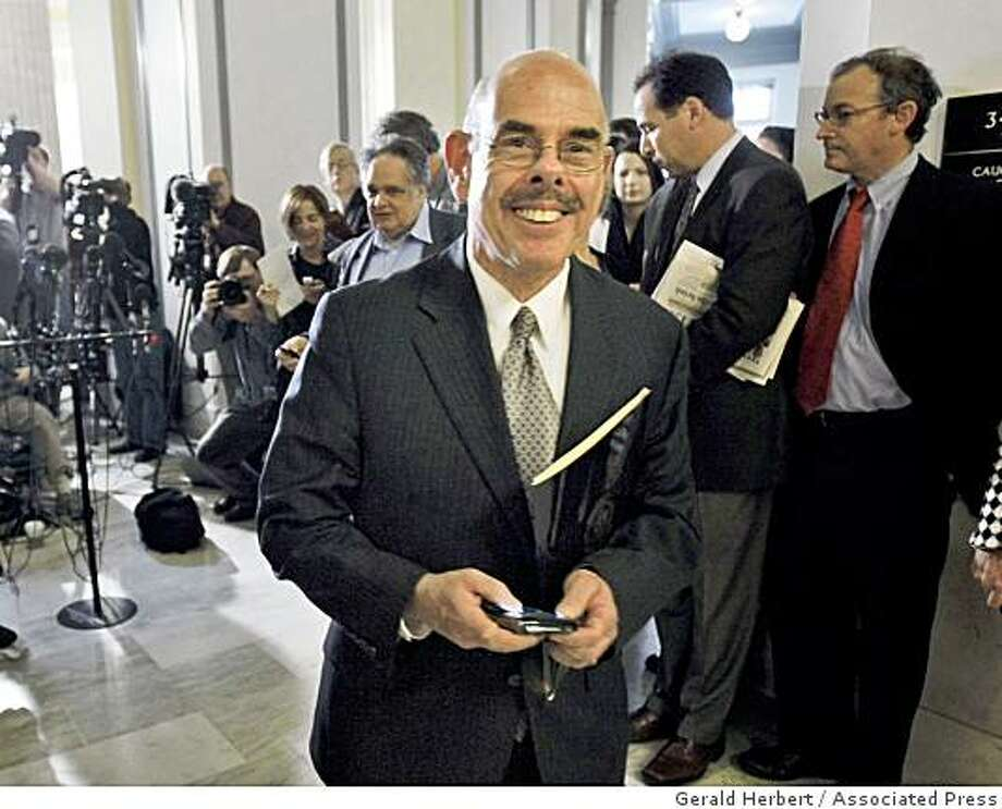 Rep. Henry Waxman, D-Calif. walks away after talking to reporters on Capitol Hill in Washington, Thursday, Nov. 20, 2008, after the  House Democratic Caucus elected him as Chairman of the House Energy and Commerce Committee over long standing chairman, Rep. John Dingell, D-Mich. Photo: Gerald Herbert, Associated Press