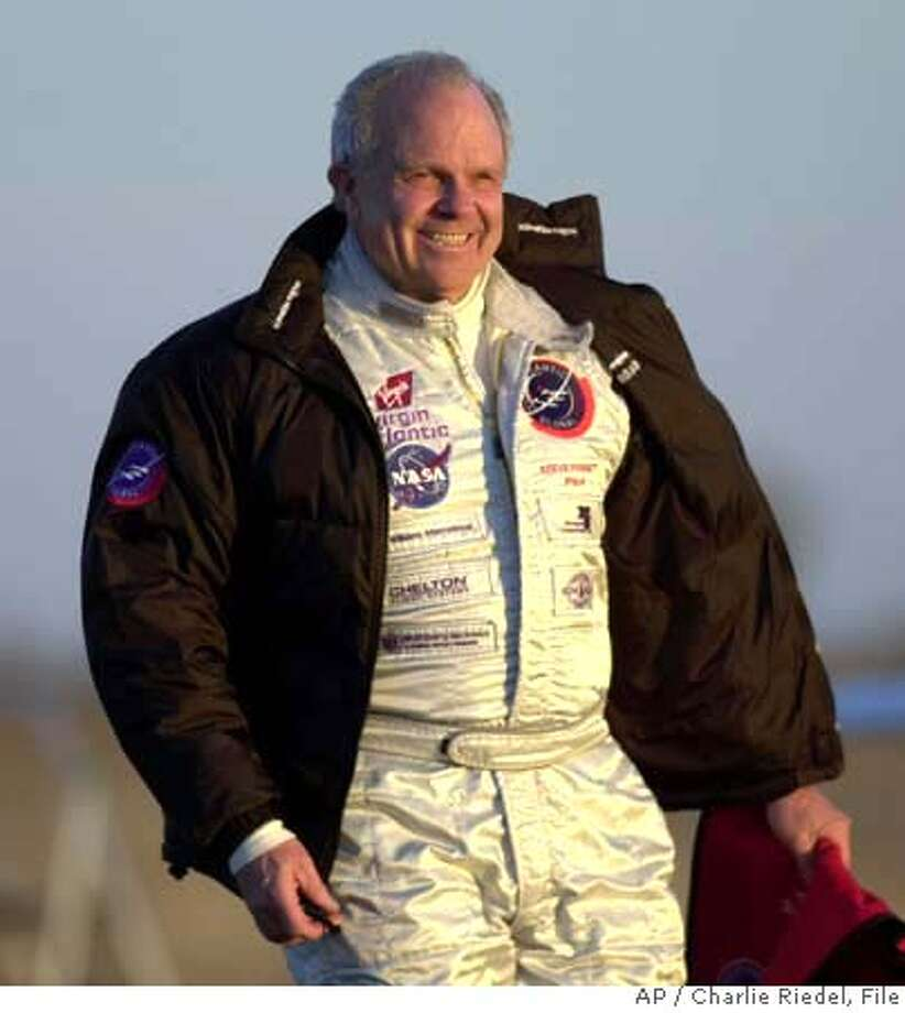 ** FILE ** Pilot Steve Fossett walks across a windy runway to the GlobalFlyer at the Salina Municipal Airport in Salina, Kan. in this Feb. 28, 2005 file photo. Fossett, who risked his life seeking to set records in high-tech balloons, gliders and jets, was declared dead on Friday, Feb. 15, 2008, five months after he vanished while flying in an ordinary small plane. (AP Photo/Charlie Riedel) FEB. 28, 2005 FILE PHOTO Photo: CHARLIE RIEDEL