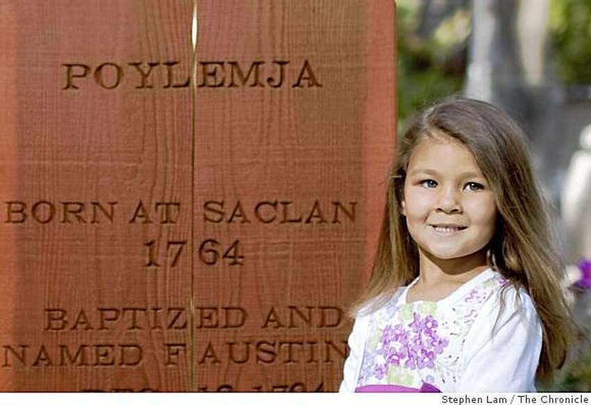 Amaya Fabio, 4, poses for a portrait next to the headstone of ancestor Faustino and Obulinda at the Mission Dolores Cemetery in San Francisco, Calif. on Friday, June 26, 2009.
