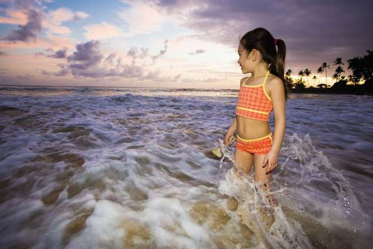 TRAVEL POIPU -- Girl Playing in Ocean Surf, Don Mason/Corbis For latest restrictions check www.corbis.com