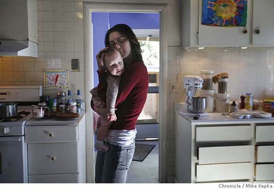 Rachel Bierach, 21, has been dealing with severe asthma for her entire life. Now concerned for her 8-month-old daughter, Violet, who shows no current signs of the disease, she is having her take part in clinical trials for possible preventative treatments for asthma in children at UCSF. photo by Mike Kepka / San Francisco Chronicle MANDATORY CREDIT FOR PHOTOG AND SAN FRANCISCO CHRONICLE/NO SALES-MAGS OUT Photo: Mike Kepka