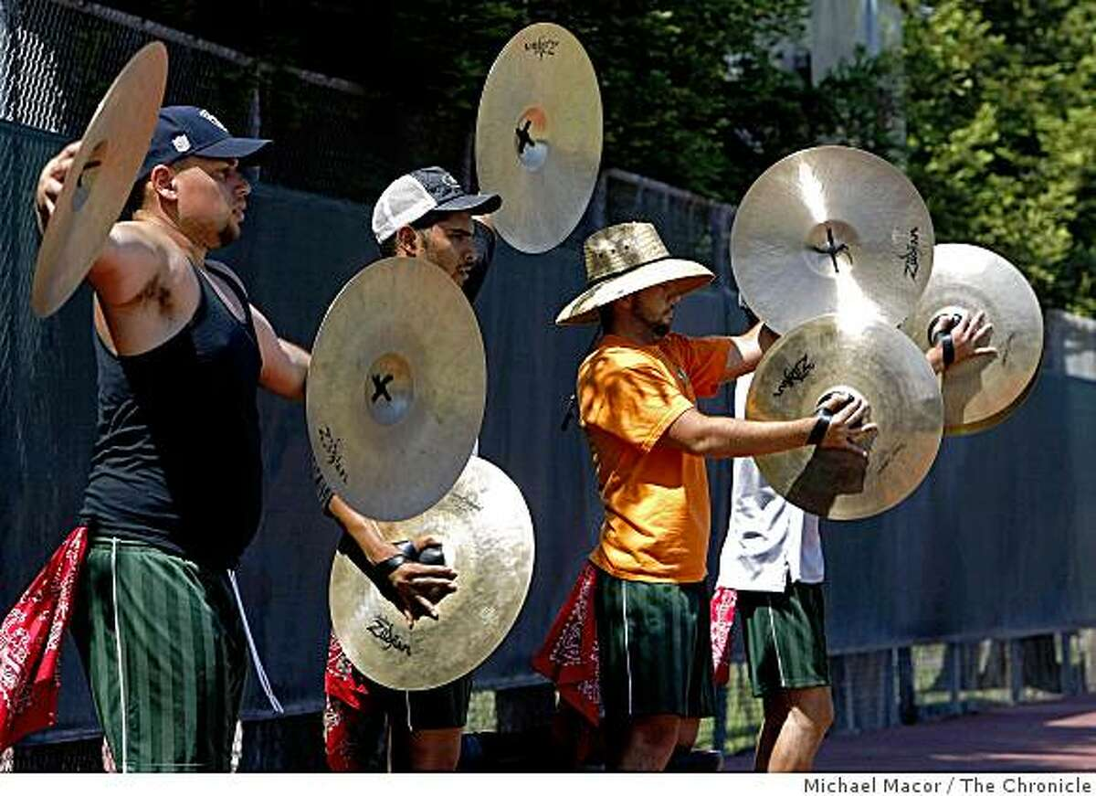 The cymbal section practicing on the tennis courts are, (left to right) Jeff Ramos, Nithin Kumar, Nick Richards and Tim Rorke as the Santa Clara Vanguard Drum & Bugle Corps is currently in rehearsals at Menlo College in Atherton, Calif. on Saturday May 30, 2009.