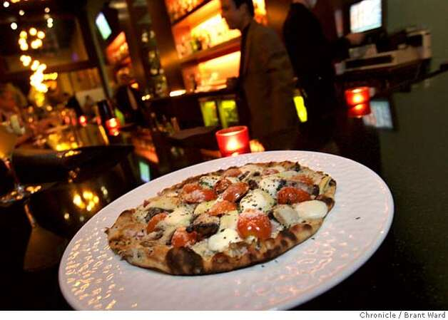"The Daru Naanizza ""pizza"" is served up at the bar at Mantra. Scenes from Mantra, 632 Emerson Street in Palo Alto.  (By Brant Ward/San Francisco Chronicle) Photo: Brant Ward"