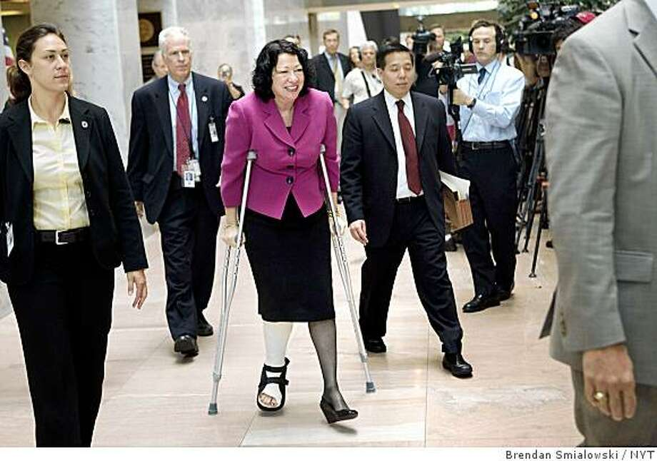 Supreme Court nominee Judge Sonia Sotomayor makes her way through Capitol Hill in Washington on Monday, June 8, 2009. Sotomayor broke her ankle Monday morning in an airport stumble, then boarded her flight as scheduled and made the roughly hourlong trip to Washington to meet with senators who will vote on her confirmation. (Brendan Smialowski/The New York Times) Photo: Brendan Smialowski, NYT
