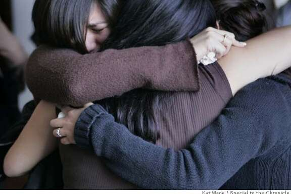 """Graduating senior students, Lisa Vera, left, Fabiola Matasol and Elizabeth Limones from professor John Dennis' """"High Potential Program 2008,"""" shed tears as they mourn the death of their teacher after a prayer service in his honor at St.Mary's College Chappel on Monday, February 11, 2008 in Moraga, Calif. Mandatory Credit for photographer, Kat Wade No Sales/Mags out"""