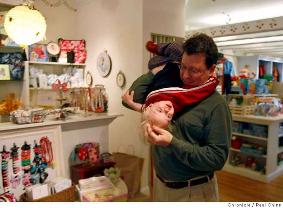 Shawn Johnson and his 20-month-old son Henry flip over shopping at Red Wagon children's store on Domingo Avenue in Berkeley, Calif. on Thursday, Feb. 7, 2008. MANDATORY CREDIT FOR PHOTOGRAPHER AND S.F. CHRONICLE/NO SALES - MAGS OUT Photo: PAUL CHINN