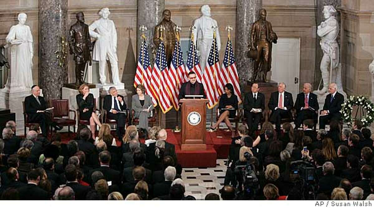 Bono speaks during the memorial service for Rep. Tom Lantos, D-Calif., Thursday, Feb. 14, 2008, on Capitol Hill in Washington. Seated, from left are, Rabbi Arthur Schneier, Israeli Foreign Minister Tzipi Livni, Nobel Peace laureate Elie Wiesel, House Speaker Nancy Pelosi of Calif, Bono, Secretary of State Condoleezza Rice, UN Secretary General Ban Ki-Moon, House Majority Leader Steny Hoyer of Md., Sen. Joseph Biden, D-Del., and Rep. Christopher Shays, R-Conn. (AP Photos/Susan Walsh)