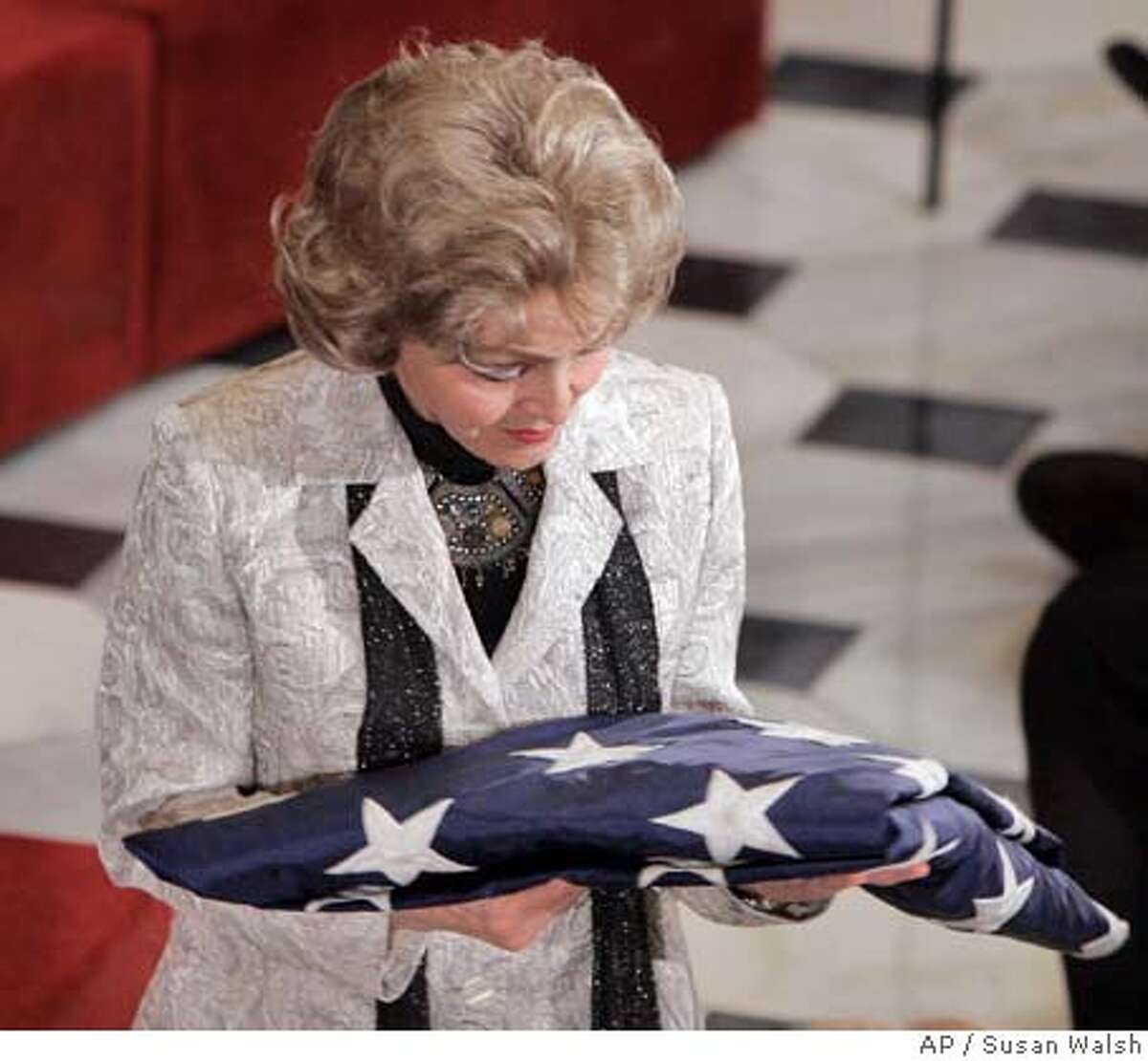 Annette Lantos, wife of the late Rep. Tom Lantos, D-Calif., holds a flag that she was presented during a memorial service for Lantos, Thursday, Feb. 14, 2008 on Capitol Hill in Washington. (AP Photos/Susan Walsh)
