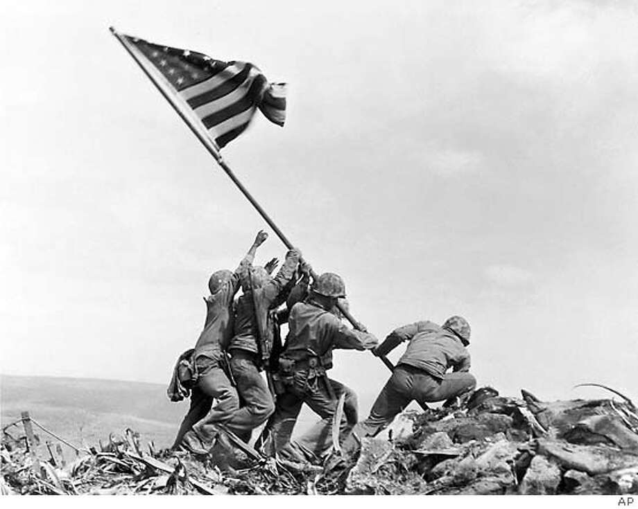Joe Rosenthal's Photo: He won the Pulitzer Prize for his famous photograph of Marines raising the U.S. flag on Mount Suribachi on Iwo Jima on Feb. 23, 1945. Associated Press file photo by Joe Rosenthal