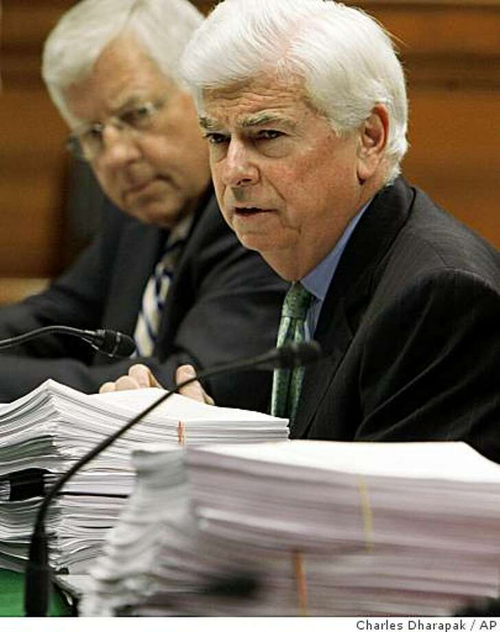 Sen. Christopher Dodd, D-Conn., right, and Senate Health, Education, Labor and Pension Committee ranking Republican Sen. Mike Enzi, R-Wyo., preside over the markup of the health care reform bill and its amendments, seen on documents before them, Wednesday, June 17, 2009, on Capitol Hill in Washington. (AP Photo/Charles Dharapak) Photo: Charles Dharapak, AP