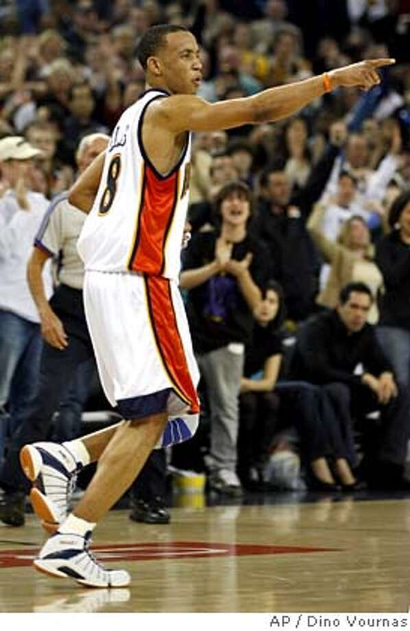 Golden State Warriors' Monta Ellis reacts after making a shot in the final seconds against the Sacramento Kings in an NBA basketball game, Saturday, Feb. 9, 2008 in Oakland, Calif. The Warriors won 105-102. (AP Photo/Dino Vournas) EFE OUT Photo: Dino Vournas