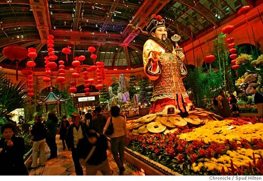 ASIAN VEGAS -- An 18-foot Chinese god of wealth and fortune is the centerpiece of Chinese New Year exhibit at the Bellagio's Conservatory and Botanical Gardens. The gardens include a koi pond, a pagoda and a 5-foot-tall rat made of alternanthera and hypoestes. Feb. 7 marked the beginning of 4706. Spud Hilton / The Chronicle Photo: Spud Hilton