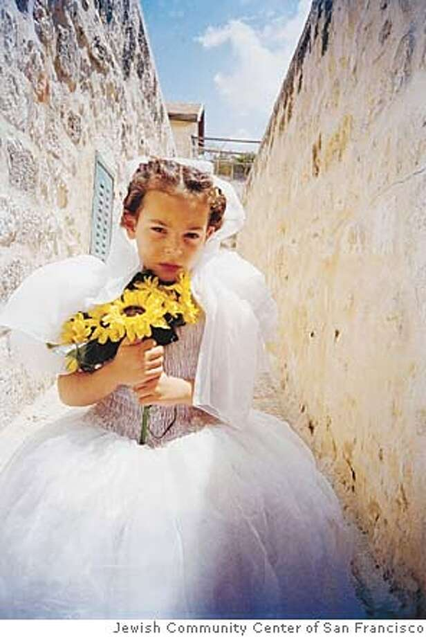 �Sister With Flowers,� shot by a 12-year-old Palestinian girl named Raneen.F