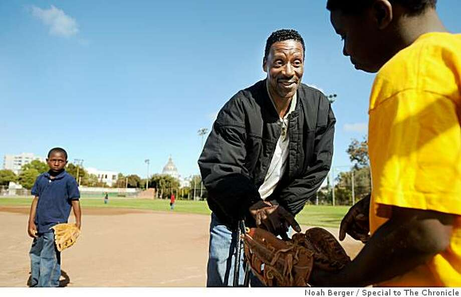Former Oakland A's pitcher Mike Norris talks to a young baseball player during a practice on Friday, June 5, 2009, in San Francisco. Photo: Noah Berger, Special To The Chronicle