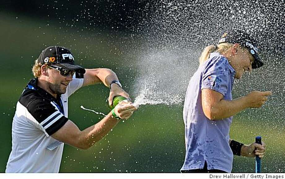 HAVRE DE GRACE, MD - JUNE 14: Anna Nordqvist of Sweden gets doused in champagne on the 18th green after winning the McDonald's LPGA Championship at Bulle Rock Golf Course on June 14, 2009 in Havre de Grace, Maryland. (Photo by Drew Hallowell/Getty Images) Photo: Drew Hallowell, Getty Images