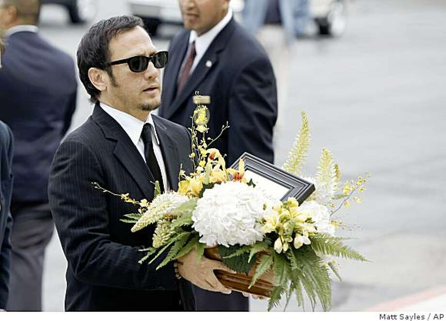 Rob Schneider arrive at the funeral of  David Carradine on Saturday June 13, 2009, in Los Angeles. (AP Photo/Matt Sayles) Photo: Matt Sayles, AP