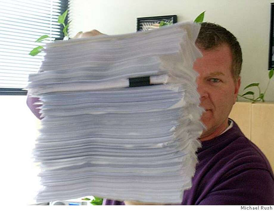 John Scott, program director at Green 960 KKGN radio, with a stack of complaint emails he got after cutting Stephanie Miller's morning show.  John Scott of Green 960 e-mailed me. It's by Michael Rush, and it's of Scott with some of the e-mails he got. Photo: Michael Rush