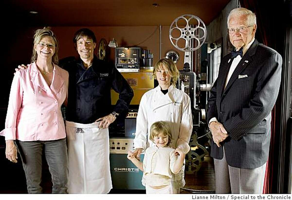 L-R: Foreign Cinema chef and owners, Gayle Pirie, with her husband, John Clark, their children, Magnus, 10, and Pearl, 3, and Gayle's father, Greig Pirie, stand near a projector upstairs of their restaurant, in San Francisco, CA., on Friday, June 12, 2009.