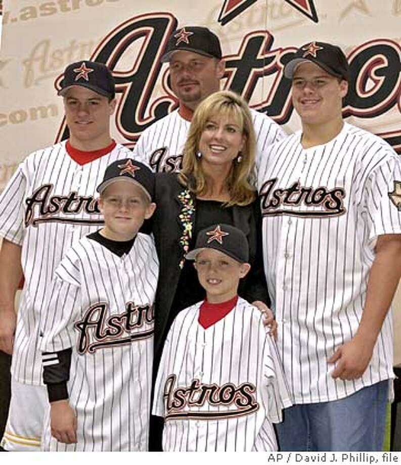 ** FILE ** Former New York Yankee pitcher Roger Clemens, rear, poses with his wife, Debbie, and their sons, Kody, 7, center, Kacy, 9, left, Kory, 15, right, and Koby, 17, far left, after a news conference with the Houston Astros in this Jan. 12, 2004 file photo, in Houston. (AP Photo/David J. Phillip, file) A JAN. 12, 2004 FILE PHOTO EFE OUT Photo: DAVID J. PHILLIP