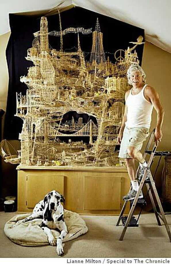 "Scott Weaver, of Rohnert Park, has spent about 3000 hours of the course of 34-years building a sculpture of San Francisco from over 100,000 toothpicks, at his home, in Rohnert Park, CA., on Friday, June 19, 2009. He calls the project, ""Rolling through the Bay,"" because of tracks for ping-pong balls throughout the nine-foot structure. Photo: Lianne Milton, Special To The Chronicle"