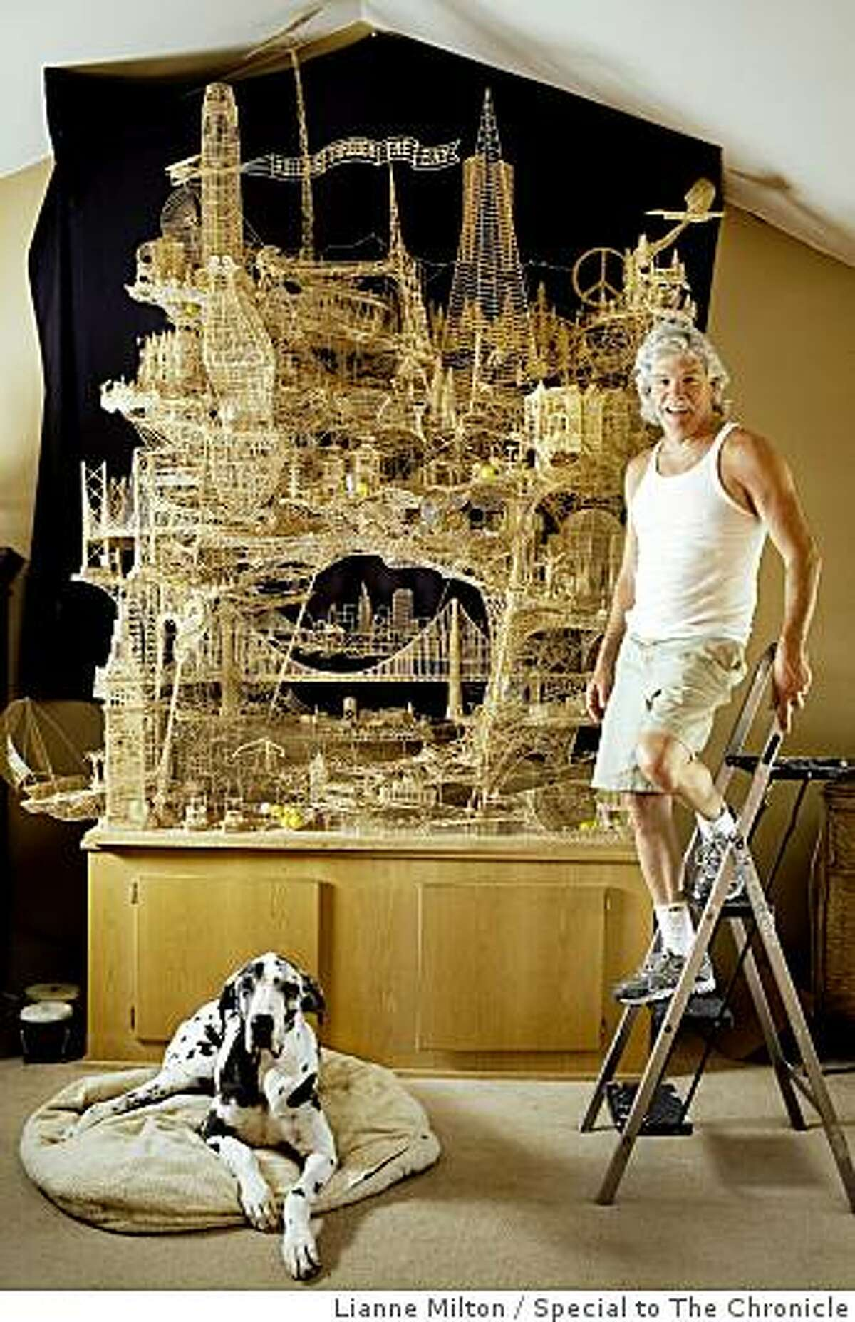 """Scott Weaver, of Rohnert Park, has spent about 3000 hours of the course of 34-years building a sculpture of San Francisco from over 100,000 toothpicks, at his home, in Rohnert Park, CA., on Friday, June 19, 2009. He calls the project, """"Rolling through the Bay,"""" because of tracks for ping-pong balls throughout the nine-foot structure."""