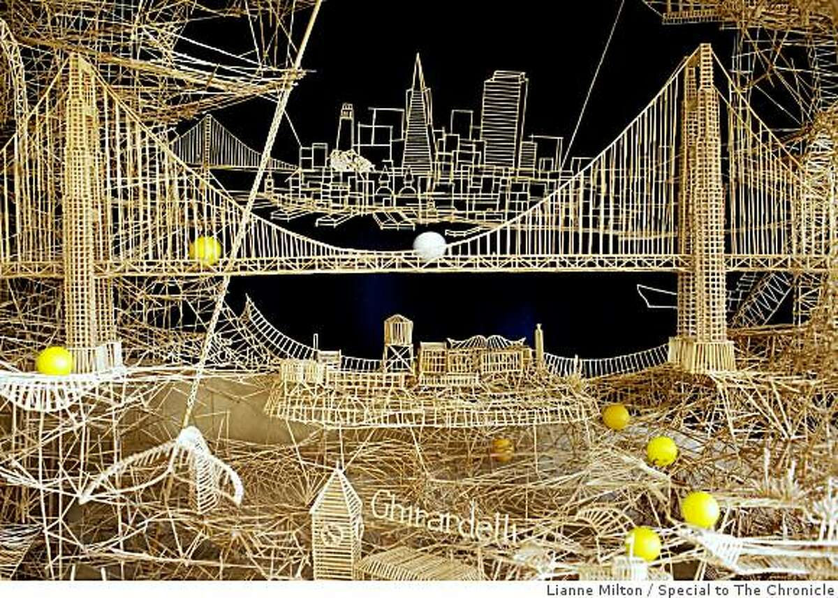 """Ping-pong balls cross the Golden Gate Bridge, which sits up Alcatraz Island, one of many sights of Scott Weaver's San Francisco structure. He has spent about 3000 hours of the course of 34-years building a sculpture of San Francisco from over 100,000 toothpicks, at his home, in Rohnert Park, CA., on Friday, June 19, 2009. He calls the project, """"Rolling through the Bay,"""" because of tracks for ping-pong balls throughout the nine-foot structure. There are """"four tours"""" for the balls."""