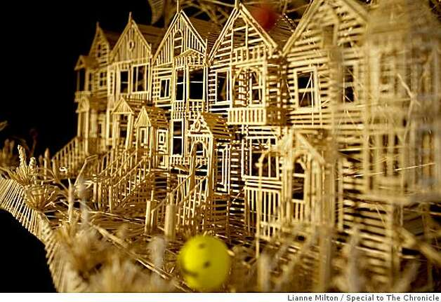 "A smiley face ball cruises down Victorian Row, one of many scenes built by Scott Weaver, of Rohnert Park, who has spent about 3000 hours of the course of 34-years building a sculpture of San Francisco from over 100,000 toothpicks, at his home, in Rohnert Park, CA., on Friday, June 19, 2009. He calls the project, ""Rolling through the Bay,"" because of tracks for ping-pong balls throughout the nine-foot structure. Photo: Lianne Milton, Special To The Chronicle"