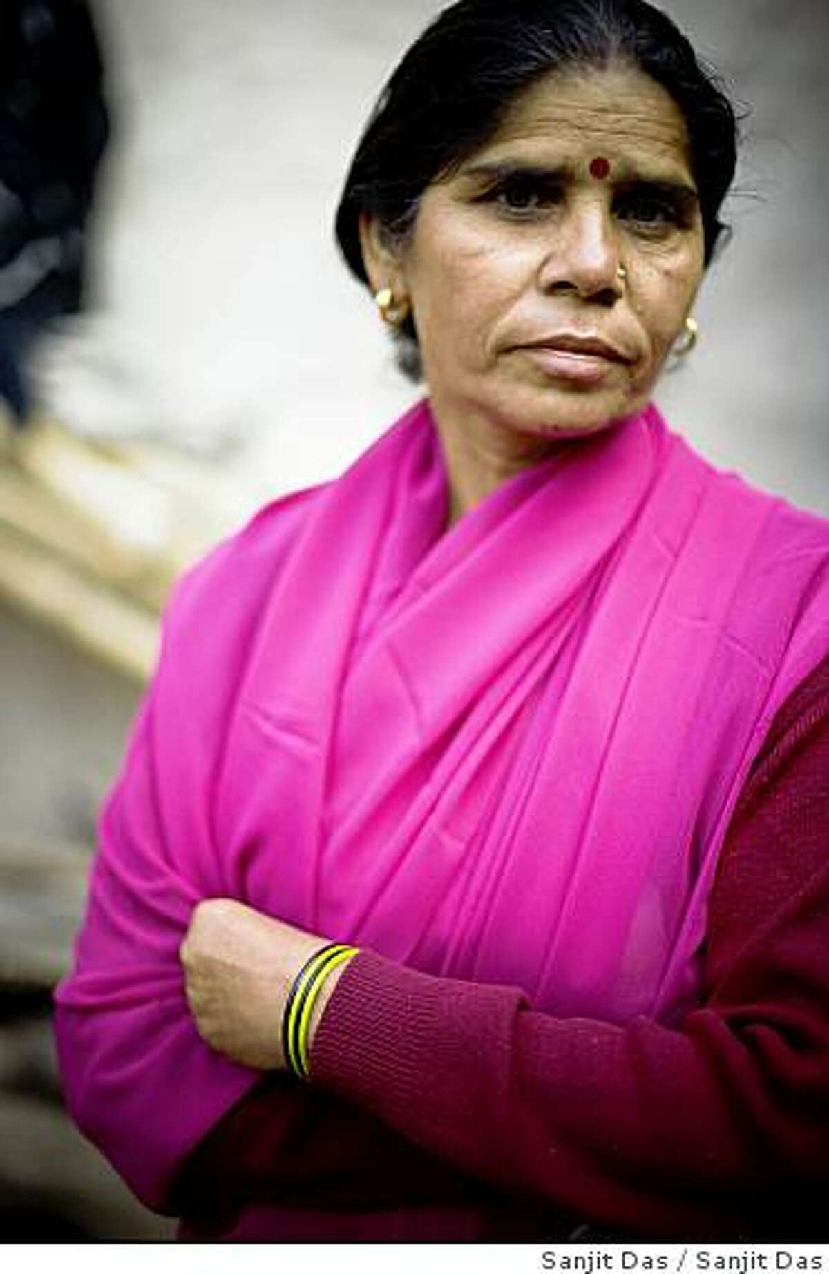 Sampath Pal Devi, 47 commander of the Pink Gang, poses for a photograph in Village of District Banda in Uttar Pradesh, India. This band of vigilantes, called the Gulabi Gang (pink gang) its several thousand swomen members wear only pink saris is taking up bamboo batons against domestic violence and corruption.The region is one of the poorest parts of India's northern and most populous states, Uttar Pradesh . The 47-year-old leader of the Pink Gang, Sampat Pal Devi is a fiesty woman. The barely educated, impoverished mother of five, has emerged as a messianic figure in the region.