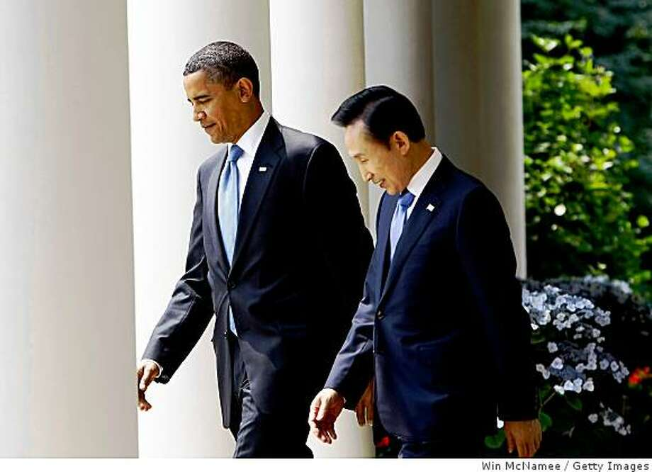 WASHINGTON - JUNE 16: U.S. President Barack Obama (L) and South Korean President Lee Myung-Bak walk into the Rose Garden for a joint press availability at the White House June 16, 2009 in Washington, DC. The two leaders held talks on topics including coordinating economic recovery efforts and responding to recent nuclear threats posed by North Korea. (Photo by Win McNamee/Getty Images) Photo: Win McNamee, Getty Images