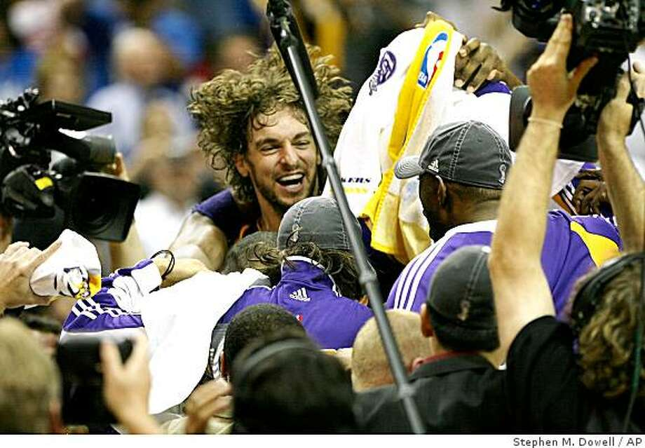 Lakers Pau Gasol, middle, celebrates with teammates after winning game five of the NBA Finals between the Los Angeles Lakers and Orlando Magic at Amway Arena on Sunday, June 14, 2009, in Orlando, Fla. (Stephen M. Dowell/Orlando Sentinel) ** NO SALES TV OUT MAGS OUT ** Photo: Stephen M. Dowell, AP
