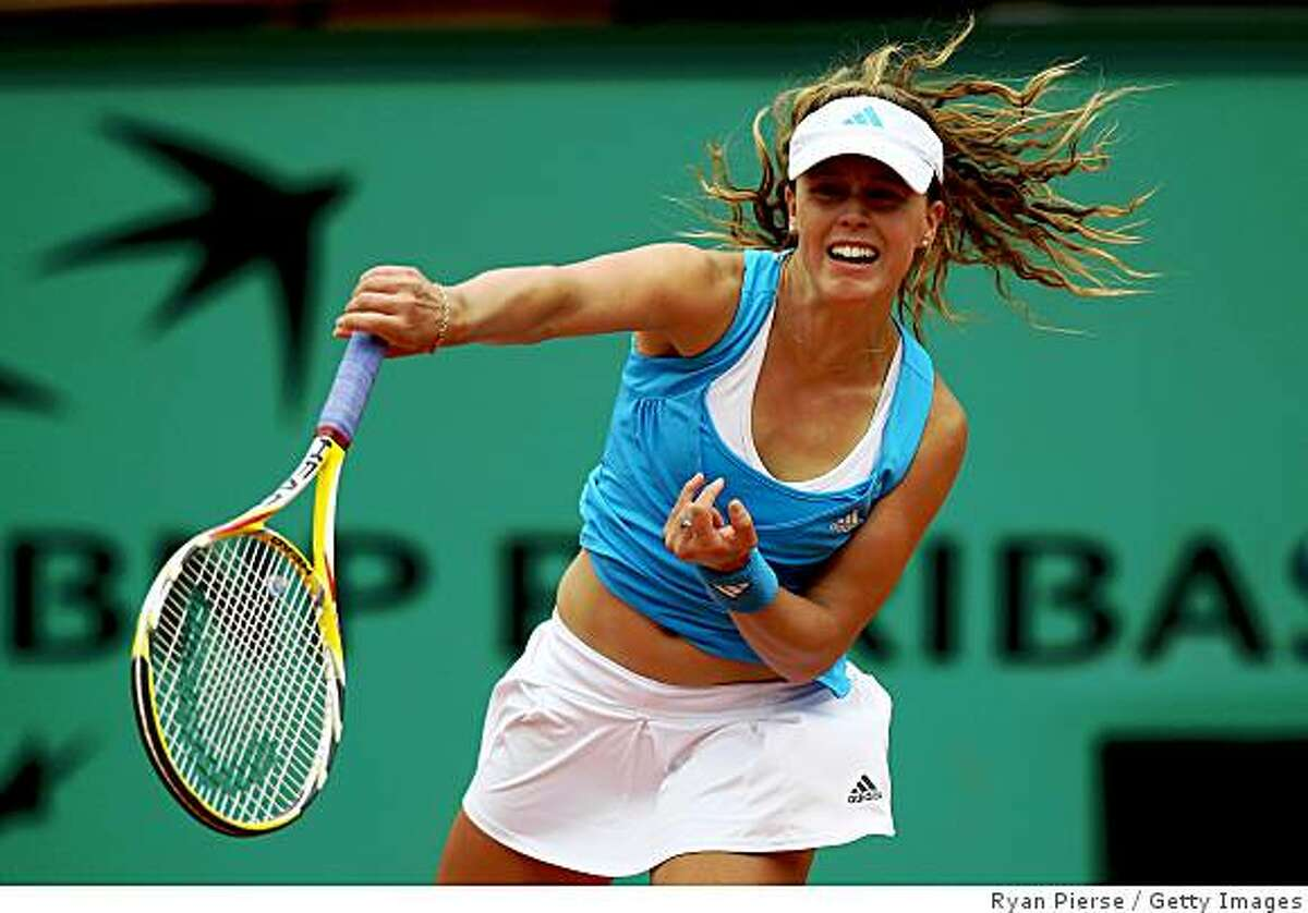 PARIS - MAY 29: Michelle Larcher De Brito of Portugal serves during the Women's Singles Third Round match against Aravane Rezai of France on day six of the French Open at Roland Garros on May 29, 2009 in Paris, France. (Photo by Ryan Pierse/Getty Images)